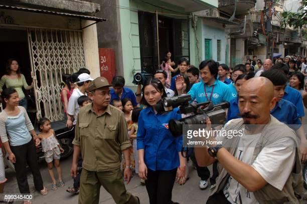 Jackie Chan Walking in Hanoi Street