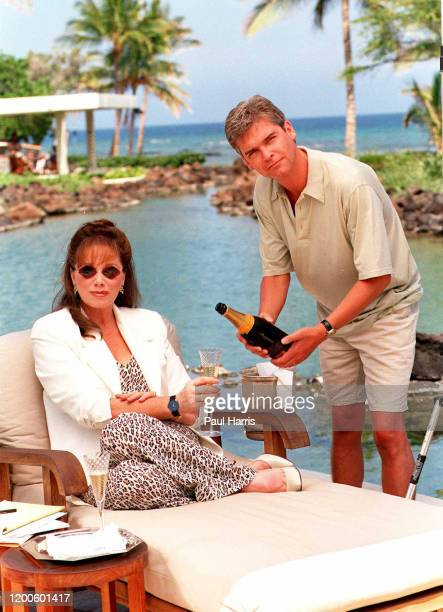 Jackie Collins author, poolside at a private bungalow Phillip Bryan Schofield who is an English television presenter who works for ITV. June 29, 1995...
