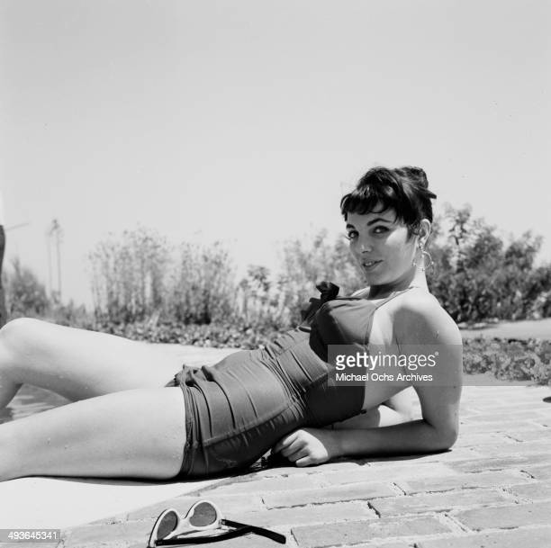 Jackie Collins poses at home by the pool in Los Angeles California