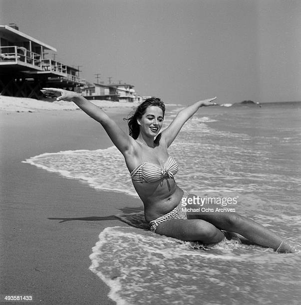 Jackie Collins poses on the beach in Los Angeles California