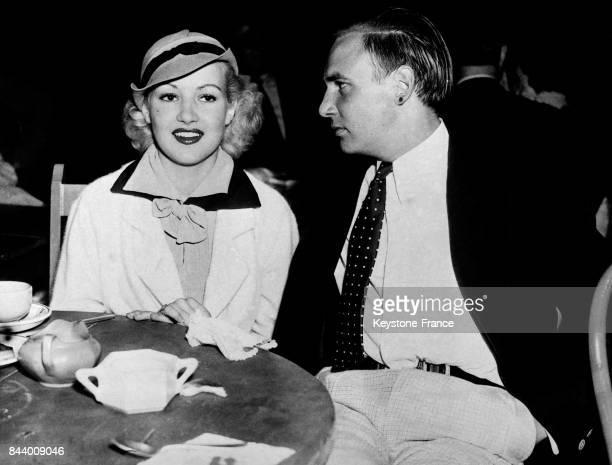 Jackie Coogan et Betty Grable actrice de cinéma lors d'une soirée au Kings Club à Hollywood Californie EtatsUnis en juillet 1935