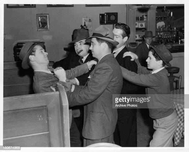 Jackie Cooper and Gene Reynolds clash with the gangsters in a scene from the film 'Gallant Sons' 1940
