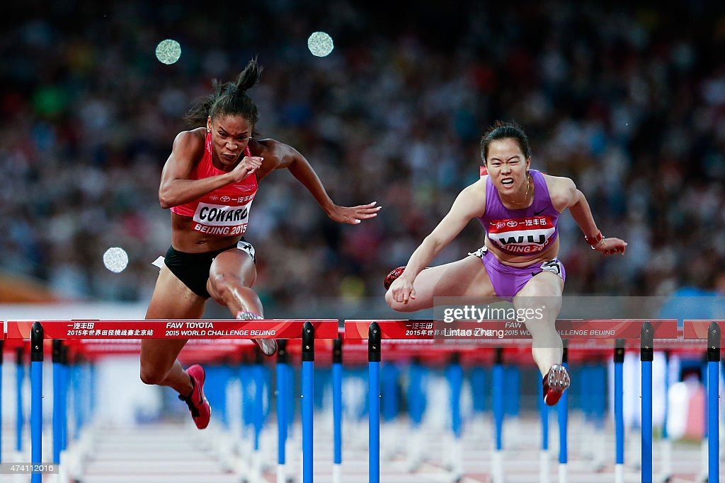 Jackie Coward (L) of the United States and Wu Shuijiao of China compete in the Women's 100m Hurdles during the 2015 IAAF World Challenge Beijing at National Stadium on May 20, 2015 in Beijing, China.
