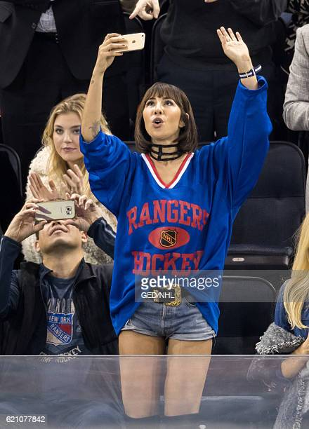 Jackie Cruz and male friend attend Edmonton Oilers Vs New York Rangers at Madison Square Garden on November 3 2016 in New York City
