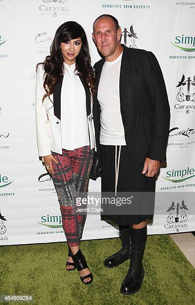 Jackie Cruz and Walter Baker attends the Simple Skincare & Caravan Stylist Studio Fashion Week Event on September 7, 2014 in New York City.