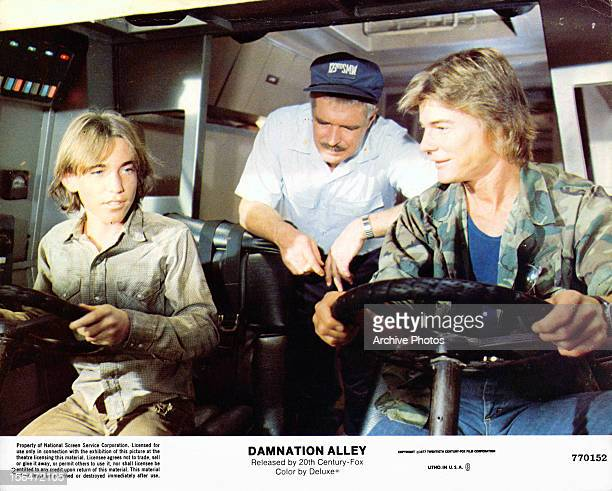 Jackie Earle Haley George Peppard and JanMichael Vincent ride in a vehicle in a scene from the film 'Damnation Alley' 1977
