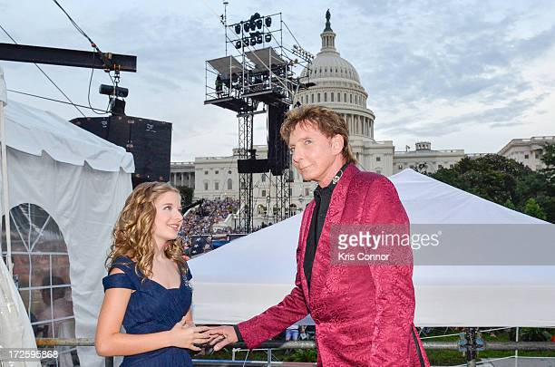Jackie Evancho and Barry Manilo pose for a photo during a rehearsal for the 'A Capitol Fourth 2013 Indepdence Day Concert' on the West Lawn of the US...