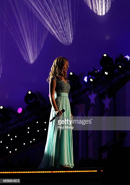 Jackie Evancho performs at the 25th National Memorial Day Concert rehearsals at US Capitol West Lawn on May 24 2014 in Washington DC