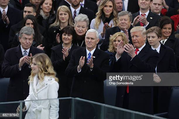 Jackie Evancho performs the National Anthem as Vice President Mike Pence and President Donald Trump clap on the West Front of the US Capitol on...
