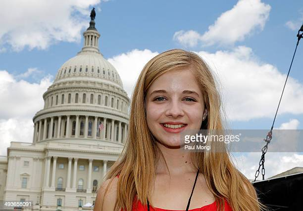 Jackie Evancho poses for a photo at the 25th National Memorial Day Concert rehearsals at US Capitol West Lawn on May 24 2014 in Washington DC