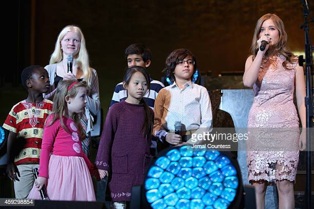 Jackie Evancho speaks on stage at the UNICEF launch of the #IMAGINE Project to celebrate the 25th Anniversary of the rights of a child at United...