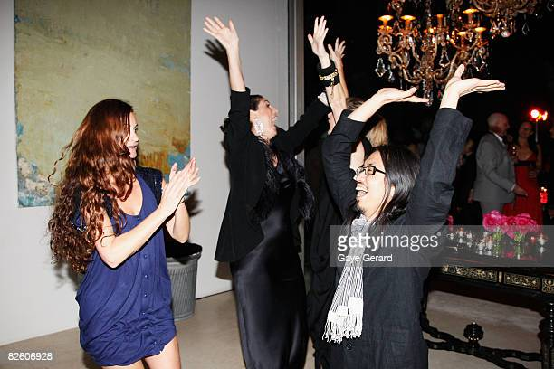 Jackie Frank judge from TV Show Make Me A Supermodel dancing with Fashion Designers Alice McCall and Akira at the Marie Claire Fashion with Heart...