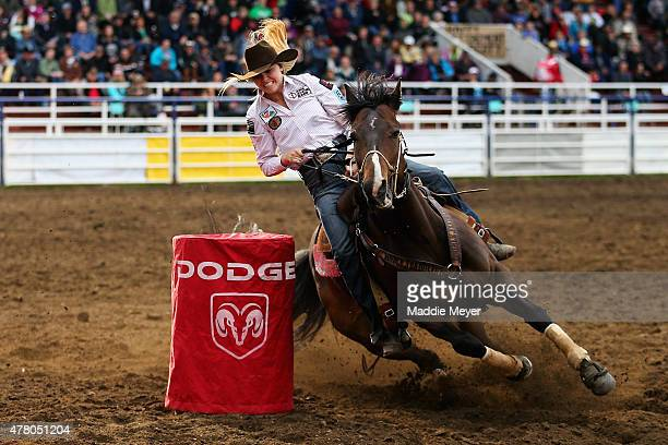 Jackie Gartner of Abilene Texas participates in the Ladies Barrel Racing during the 62nd Annual Wainwright Stampede on June 21 2015 in Wainwright...