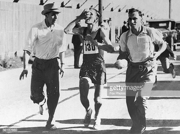 Jackie Gibson of South Africa refreshes himself during the marathon event at the British Empire Games in Sydney 1938 He came third taking the bronze...