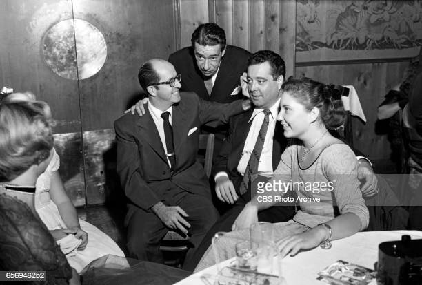 Jackie Gleason celebrates with guests including Phil Silvers and daughter Geraldine Gleason at The Jackie Gleason Show after party at Toots Shors...