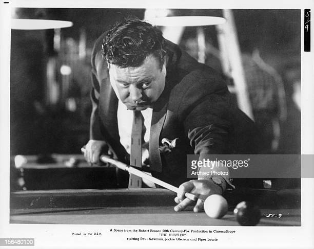Jackie Gleason shoots pool in a scene from the film 'The Hustler' 1961