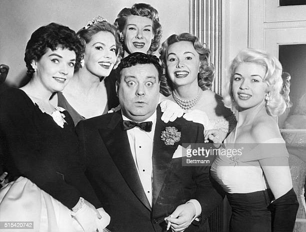Jackie Gleason stares in disbelief as beautiful actresses surround him at the Testimonial Dinner given in his honor at the Waldorf Astoria by the...