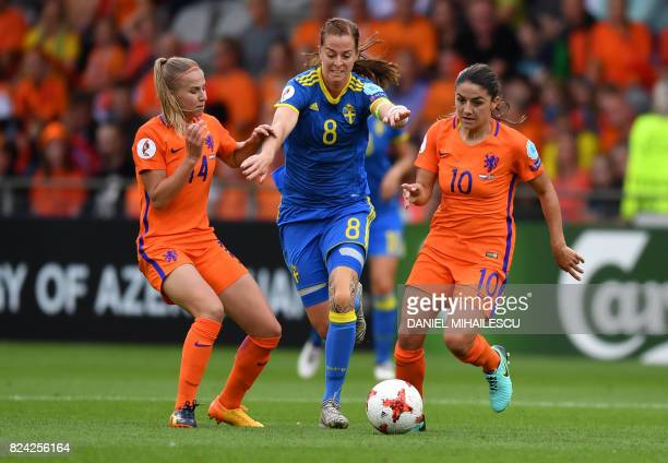 Jackie Groenen and Danielle van de Donk of The Netherlands vies with Sherida Spitse of Sweden during the UEFA Womens Euro 2017 football match between...