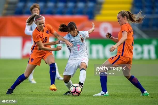 Jackie Groenen Emi Nakajima of Japan and Desiree van Lunteren of Netherlands fight for the ball during the Women's International Friendly match...
