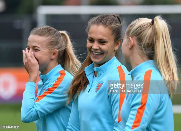 Jackie Groenen Lieke Martens and Jill Roord of The Netherlands attend a training session in the eve of the UEFA Women's Euro 2017 football tournament...