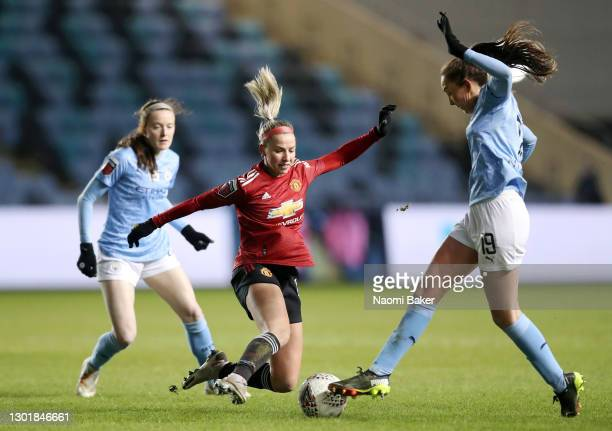 Jackie Groenen of Manchester United tackles Caroline Weir of Manchester City during the Barclays FA Women's Super League match between Manchester...
