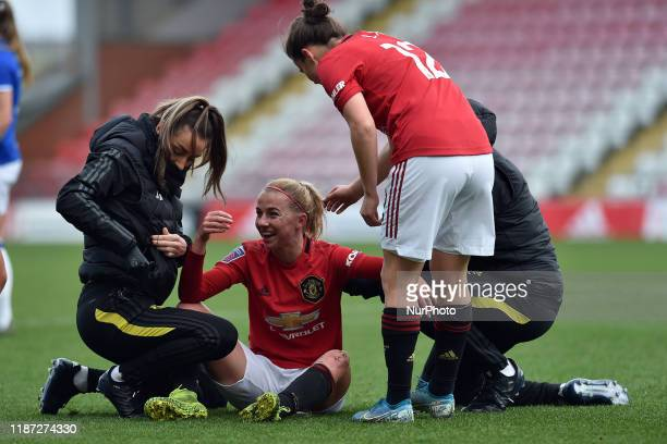 Jackie Groenen of Manchester United Women gets treatment after being hit in the face by the ball during the Barclays FA Women's Super League match...