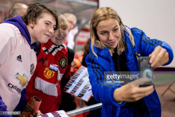 Jackie Groenen of Manchester United Women signs autographs for fans after the Barclays FA Women's Super League match between Manchester United and...