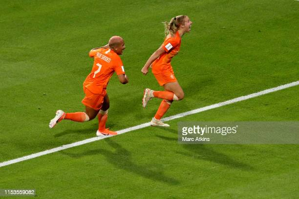 Jackie Groenen of Netherlands celebrates scoring the opening goal with Shanice van de Sanden during the 2019 FIFA Women's World Cup France Semi Final...