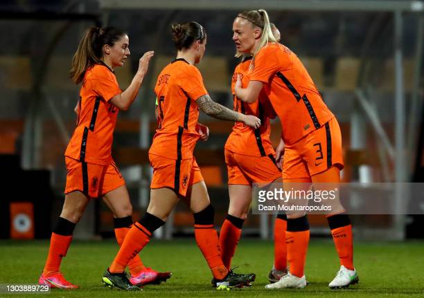 Jackie Groenen of Netherlands celebrates with Stephanie van der Gragt and team mates after scoring their side's first goal during the Three...