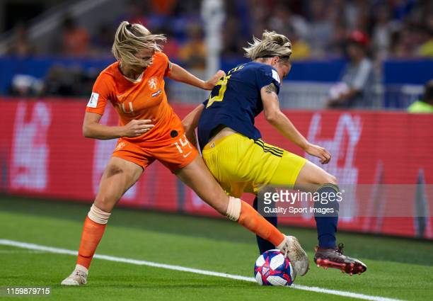 Jackie Groenen of Netherlands competes for the ball with Lina Hurtigs of Sweden during the 2019 FIFA Women's World Cup France Semi Final match...