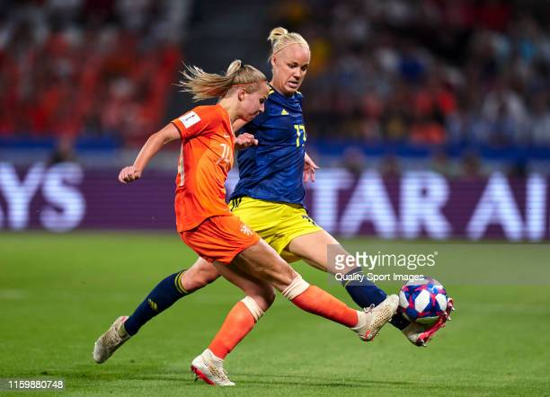 Jackie Groenen of Netherlands competes for the ball with Stina Blackstenius of Sweden during the 2019 FIFA Women's World Cup France Semi Final match...