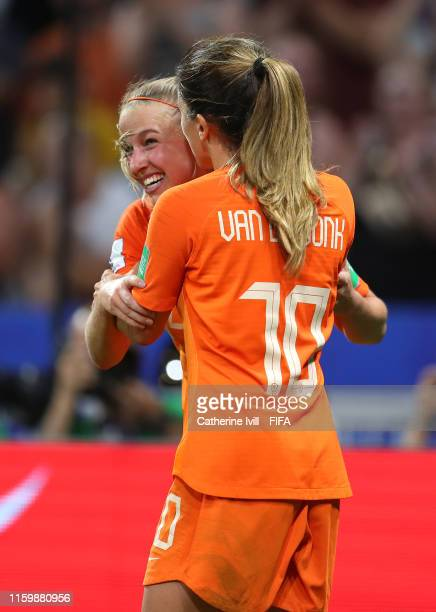 Jackie Groenen of the Netherlands celebrates after scoring her team's first goal with teammate Danielle Van De Donk during the 2019 FIFA Women's...