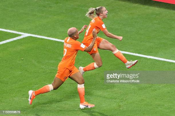 Jackie Groenen of the Netherlands celebrates scoring the winning goal in extra time with Shanice Van De Sanden during the 2019 FIFA Women's World Cup...