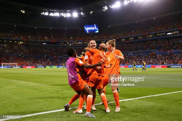 Jackie Groenen of the Netherlands celebrates with teammates after scoring her team's first goal during the 2019 FIFA Women's World Cup France Semi...