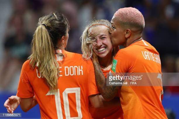 Jackie Groenen of the Netherlands celebrates with teammates Danielle Van De Donk and Shanice Van De Sanden after scoring her team's first goal during...