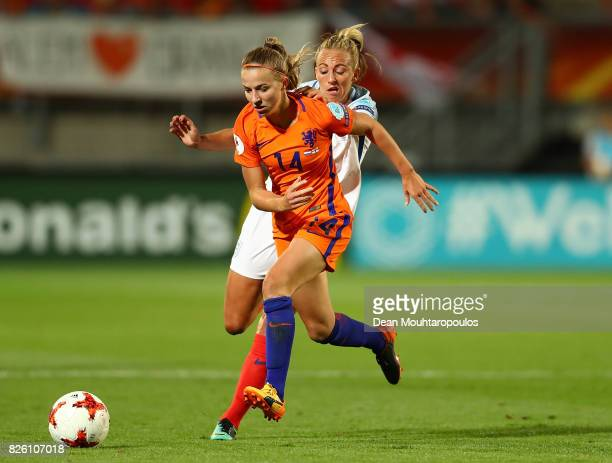 Jackie Groenen of The Netherlands holds off pressure from Toni Duggan of England during the UEFA Women's Euro 2017 Semi Final match between...