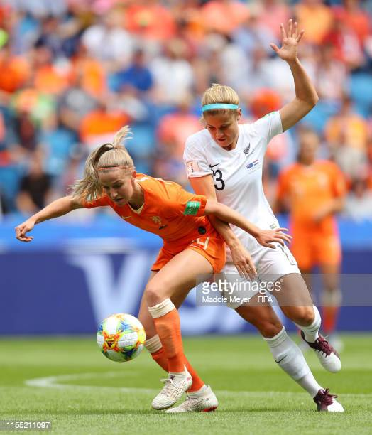Jackie Groenen of the Netherlands is challenged by Rosie White of New Zealand during the 2019 FIFA Women's World Cup France group E match between New...