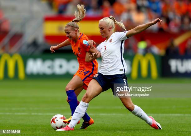Jackie Groenen of the Netherlands is tackled by Maria Thorisdottir of Norway during the Group A match between Netherlands and Norway during the UEFA...