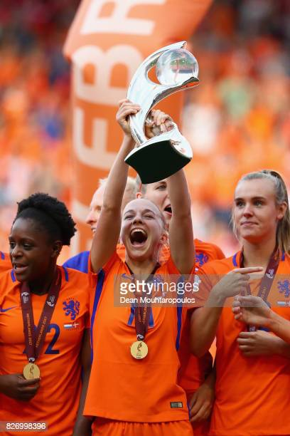 Jackie Groenen of the Netherlands lifts the trophy following the Final of the UEFA Women's Euro 2017 between Netherlands v Denmark at FC Twente...