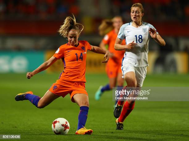Jackie Groenen of The Netherlands looks to pass under pressure from Ellen White of England during the UEFA Women's Euro 2017 Semi Final match between...