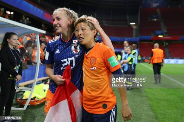 Jackie Groenen of the Netherlands speaks with Kumi Yokoyama of Japan following the 2019 FIFA Women's World Cup France Round Of 16 match between...