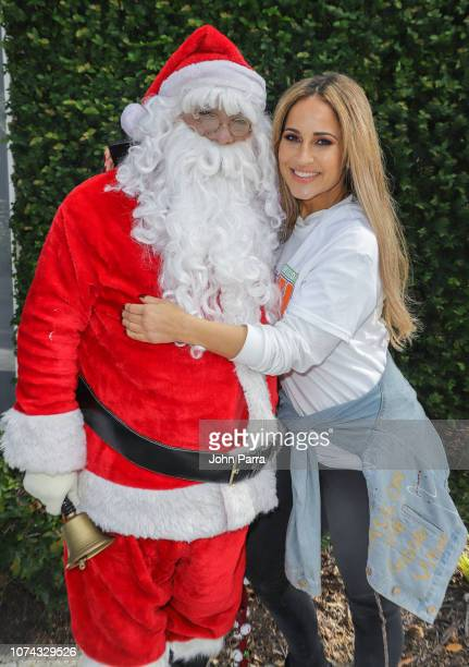 Jackie Guerrido and Santa are seen at Amigos For Kids 27th Annual Holiday Toy Drive on December 16 2018 in Miami Florida