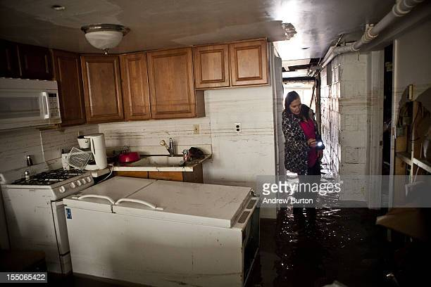 Jackie Hoey inspects the first floor of her home which experienced heavy flooding due to Hurricane Sandy on October 31 2012 in Long Beach New YorkThe...