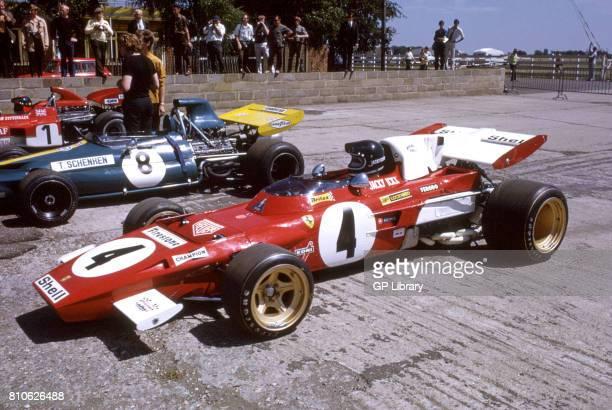 Jackie Ickx in a Ferrari 312T and Tim Schenken in a Brabham BT33 12th at Silverstone British GP