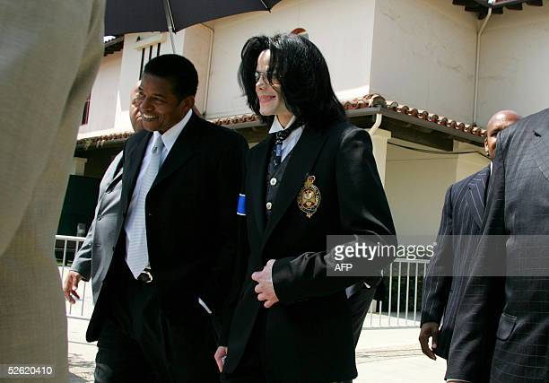 Jackie Jackson and Michael Jackson exit the Santa Barbara County courthouse 12 April 2005 in Santa Maria California The mother of Michael Jackson's...