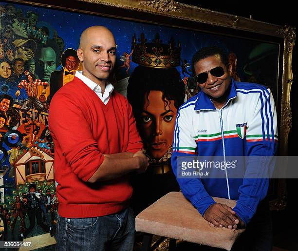 Jackie Jackson and painter/illustrator Kadir Nelson with the painting of Michael Jackson done by Nelson December 8 2010 in Los Angeles California