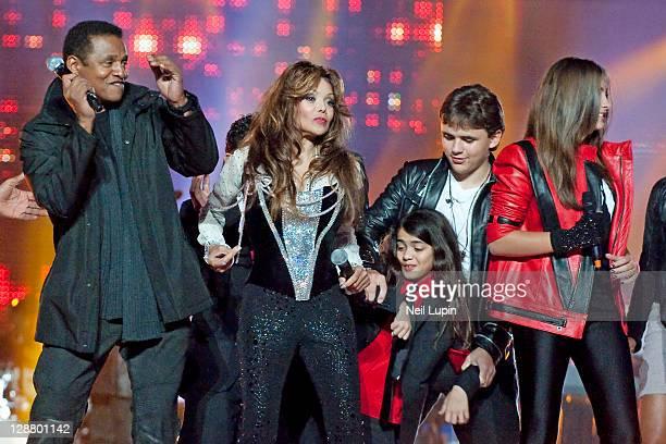 Jackie Jackson La Toya Jackson Prince Michael Jackson Blanket Jackson and Paris Jackson on stage during the Michael Forever Tribute at Millenium...