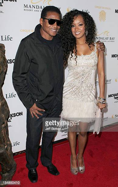 Jackie Jackson poses on the red carpet with actress Jennia Fredrique as they arrive at the Las Vegas premiere of Michael Jackson THE IMMORTAL World...