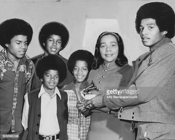 Jackie Jackson presents a GRAMMY to Mrs Coretta King for the album titled Why I am Opposed to the War in Vietnam from left Michael Tito Jermaine and...
