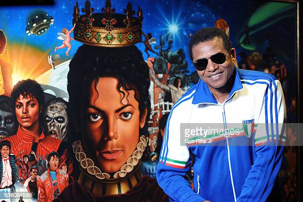 Jackie Jackson with the painting of Michael Jackson done by painter/illustrator Kadir Nelson December 8 2010 in Los Angeles California